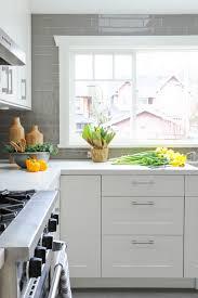 white kitchen with grey backsplash view full size