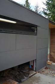 maui garage doorsAccent planks on this CHI cedar door make it a strong statement