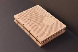 llibre homenatge a book with an egraved wooden cover