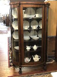 an absolutely stunning painted black glass fronted display cabinet or amoire it s been lovely up cycled and red with pretty wallpaper lining