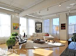 Custom window treatments are fitted on all 12 windows providing privacy  with suffused light.