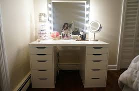 makeup vanity desk featuring with bulb lights framed mirror and bottom double side cabinet runner topped with table makeup mirror and acrylic shelves