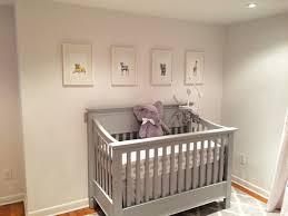A beautiful nursery in grey and cream tones featuring my safari animal  nursery artwork.