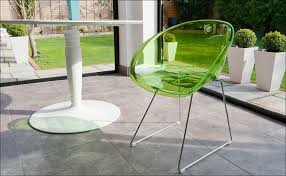 modern acrylic furniture. Transparent Green Chairs Looks Preety Coupled With White Round Table Single Leg Decorating Modern Terrace That Also Equipped Decorative Plants In Acrylic Furniture