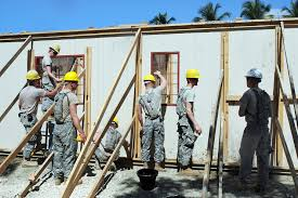 u s department of defense photo essay  u s iers put up a wall and window frames for a medical clinic during beyond the
