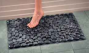 River Rock Bath Mat - use a plain bath mat in a color to match your rocks.  Hot glue and Dollar Store river rocks. Could be door mat too.