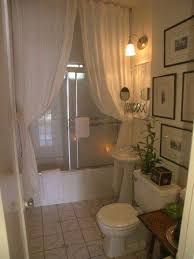 small but beautiful white bathroom with double white shower curtains... Bathroom  Decor Ideas