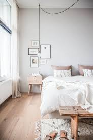 Neutral grey and cream tones paired with natural textures create a dreamy,  calm bedroom