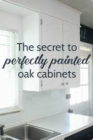 painting wood cabinets whitePainting oak cabinets white An amazing transformation  Lovely Etc