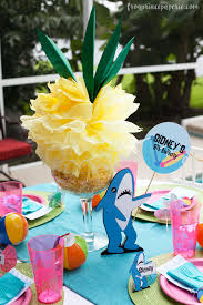 diy tissue paper pineapples and a helpful sign holding left shark make for fun pool