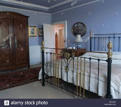 Pale Blue Bedroom Antique Brass Bed In Pale Blue French Country Bedroom With Oak