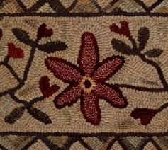 heart and vine primitive hooked rug pattern designed by