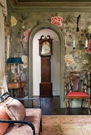 Chinoiserie style mural with Tabriz rug and settee in complementary colors  and a grandfather clock watching over it all.