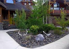 Small front yard landscaping idea with almost no maintenance required. This  rock garden was designed