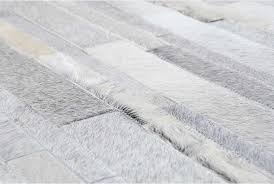 hair on hide detail of gray and white patchwork cowhide rug in stripes