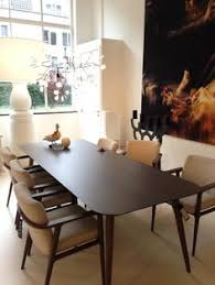 an 8 seater wooden dining table for modern dining room sets
