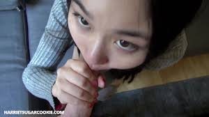 Petite asian teen Yumi Sugarbaby sucks a hard cock in the bathtub.