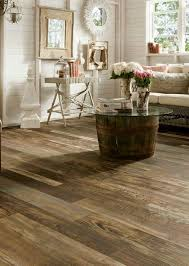 mixed wood species in are shown in this gorgeous laminate flooring from armstrong woodland reclaim from the architectural remnants collection