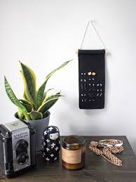 minimal stud earring organizer you can make from a strip of leather