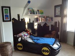 Super hero room :) love the painted car bed!
