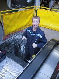 kone escalator. kone engineer repairing an escalator at canary wharf. 8