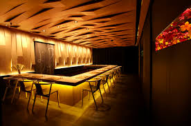 bar interiors design 2. The Interiors Feature Tiled Walls And Cut-out Windows Displaying Some 3000 Origami Flowers Amid Leather Seating Dark Wooden Tables. Bar Design 2 N