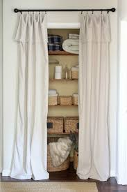 DIY: Clever Hacks Closet Door Alternative - a drop cloth cut in half,  folded over and hung with curtain clips. This is a quick, easy and  inexpensive fix for ...