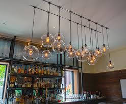 industrial bar lighting. Groups Of Different Size Globe Sphere Pendant Bar Lights Made From Glass  Clear Transparent Adorable Glow Industrial Lighting