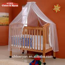 chinese factory baby furniture new zealand pine and mdf new born baby bed with stroller wheels