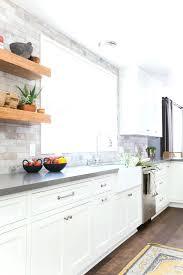 white cabinets kitchen kitchens with dark floors