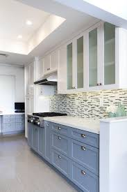 white and blue combination for kitchen wall cabinet and also mosaic tile on hardwood floor
