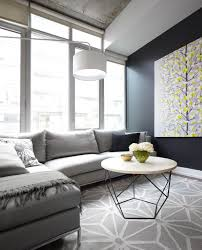 furniture for condo living. contemporary condo living room with gray sofa geometric area carpet and black feature wall furniture for d