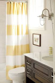 Yellow and Brown Bathroom with Stripe Shower Curtain
