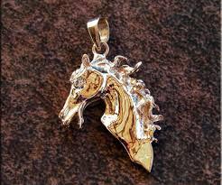 14k gold vs diamond horse head pendant