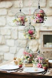 bird mini cages with flowers as centerpieces and hanging decor