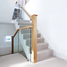 by combining cut string glass and oak this staircase has been transformed into a modern masterpiece