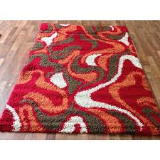 brown and orange area rug red abstract swirls red gy area rug brown orange white accents contemporary swirls pattern modern red orange and brown