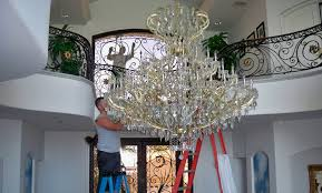is that gorgeous crystal chandelier looking like less and less of a good idea as cobwebs form and you contemplate getting on a ladder to deal with it