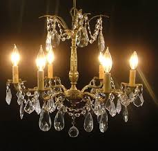 chandeliers that have been hanging for decades or d in the attic receive expert attention in the restoration process chandeliers are rewired