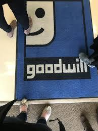 goodwill logo rug auction house
