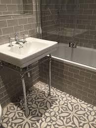 Vintage metro meets floral cement tiles in this stunning bathroom  combination. #bathroomtiles #vintagetiles