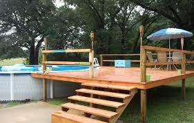 above ground pool decks. Here We Have A Budget, No Nonsense Approach To Pool Decking. The Steps And Platform Provide An Entrance Pool, With Enough Space For Seating Area Above Ground Decks