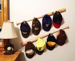 Baseball Bat Peg Hat Racks by calchicbyjacquiek on Etsy. I strongly dislike  baseball, but this is a cute starter idea -- maybe hockey sticks?