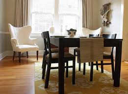 elegance yellow dining room rug decoration under dark wooden dining table set as well white chair