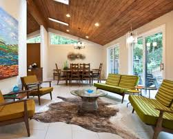 view in gallery modern living room featuring a pitched wooden