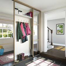 mirrored internal sliding door in halfway open to ilrate storage capabilities