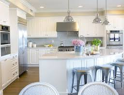 Amazing kitchen features white cabinets accented with polished nickel  hardware topped with Silestone Lagoon countertops paired with Walker Zanger  Avenue ...
