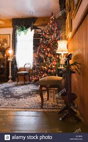 living room with christmas tree inside a 1904 victorian old house interior