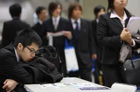graduates needn t be hostages to advance contracts the times enjoy it while it lasts university students attend a job fair in tokyo the