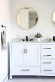 white bathroom cabinets with bronze hardware. creating our master bathroom with freestanding tub white cabinets bronze hardware